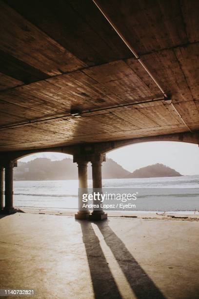scenic view of beach seen from pier - san sebastian spain stock pictures, royalty-free photos & images