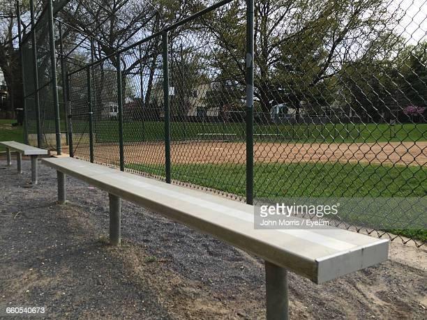 scenic view of benches next to sports field - 野球場 ストックフォトと画像