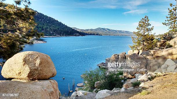 scenic view of big bear lake against sky - big bear lake stock pictures, royalty-free photos & images