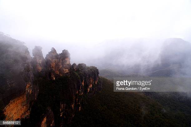scenic view of blue mountains in foggy weather against clear sky - blue mountains national park stock pictures, royalty-free photos & images