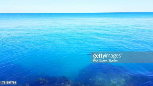 Scenic View Of Blue Sea Against Clear Sky