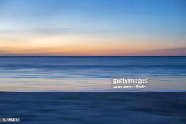 Scenic View Of Blue Sea Against Sky During Sunset