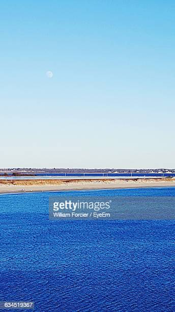 scenic view of blue sea against sky - william moon stock pictures, royalty-free photos & images