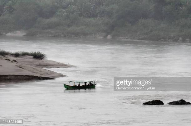 scenic view of boat in river - gerhard schimpf stock pictures, royalty-free photos & images