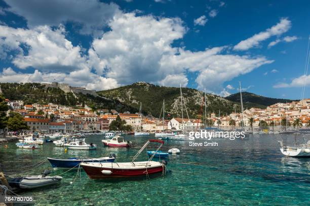 scenic view of boats in marina - hvar stock photos and pictures