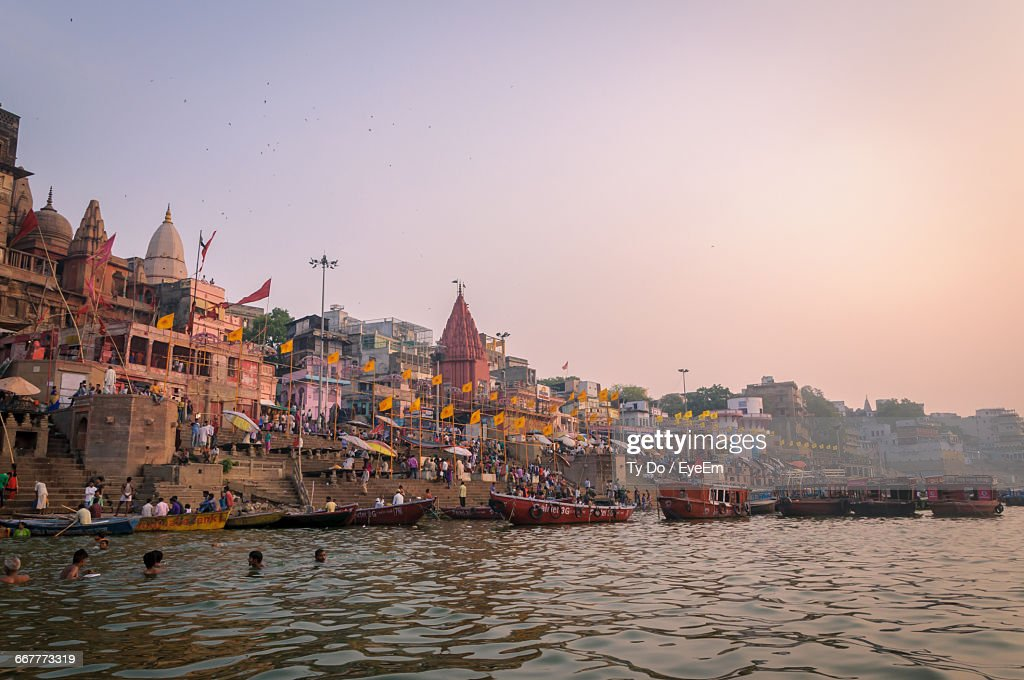Scenic View Of Boats In River Next To Temple Against Clear Sky : Stock Photo