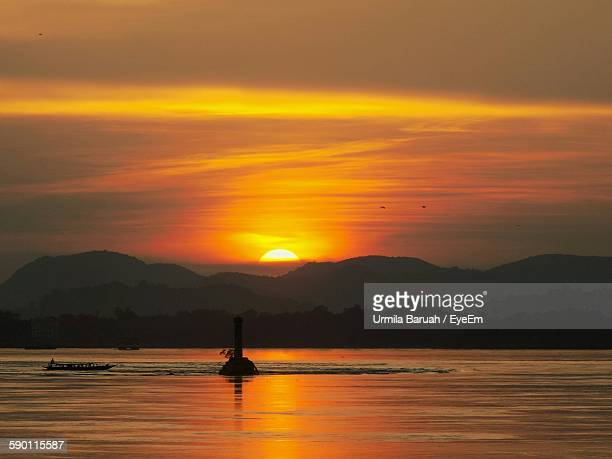 Scenic View Of Brahmaputra River Against Sky At Sunset