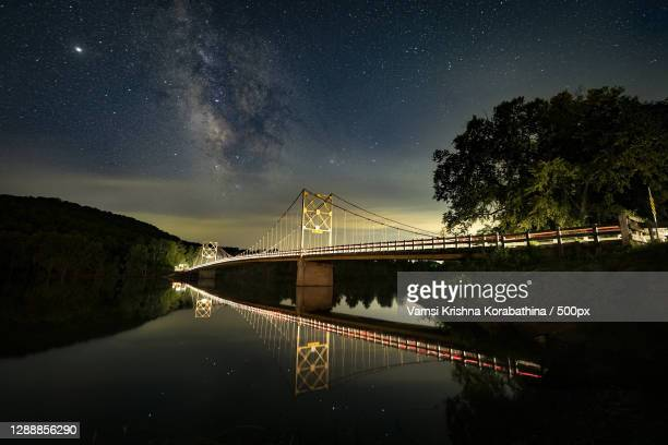 scenic view of bridge over river against sky at night,eureka springs,arkansas,united states,usa - arkansas stock pictures, royalty-free photos & images