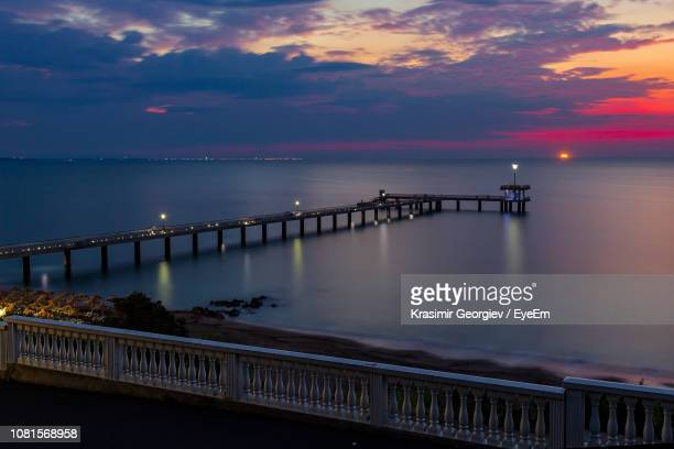 scenic view of bridge over sea against sky during sunset - krasimir georgiev stock photos and pictures