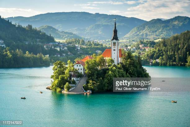 scenic view of building against sky - slovenia stock pictures, royalty-free photos & images