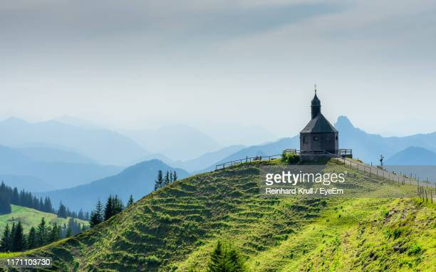 scenic view of building and mountains against clear sky - chapel stock pictures, royalty-free photos & images