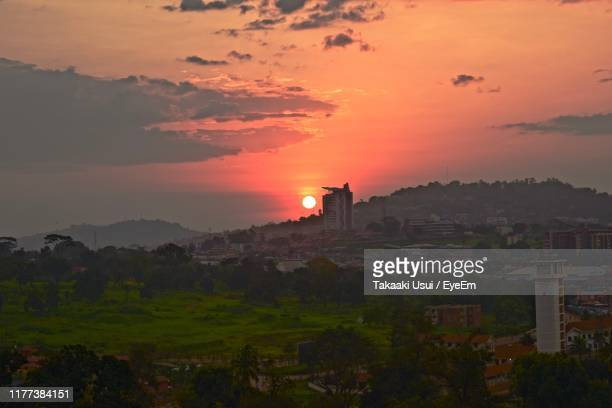 scenic view of buildings against sky during sunset - kampala stock pictures, royalty-free photos & images