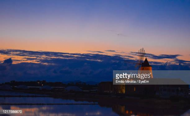 scenic view of buildings against sky during sunset - marsala sicily stock pictures, royalty-free photos & images