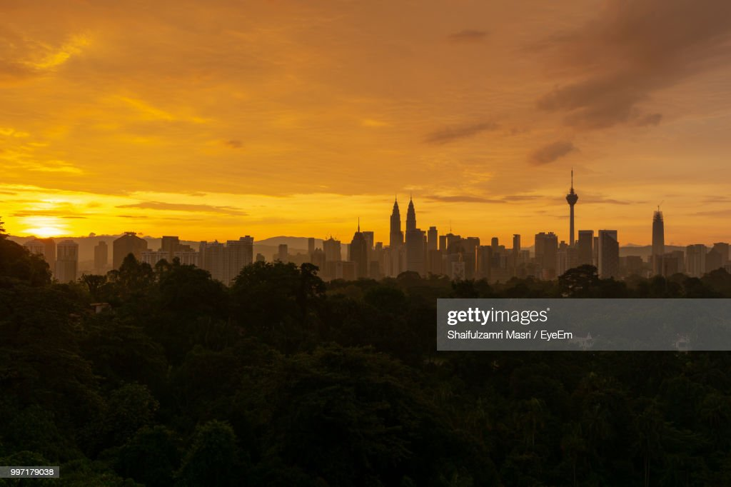 Scenic View Of Buildings Against Sky During Sunset : Stock Photo