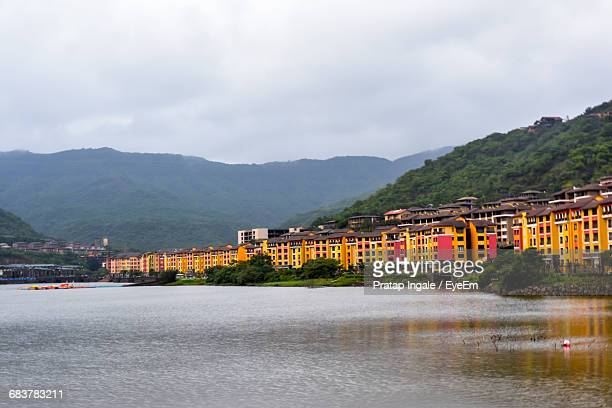 Scenic View Of Buildings Along Lakeshore