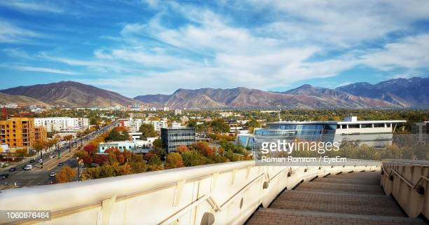 scenic view of buildings in city against sky - salt lake city utah stock pictures, royalty-free photos & images