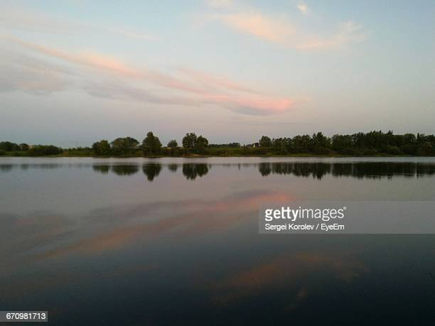 scenic view of calm lake at sunset - sergei stock pictures, royalty-free photos & images