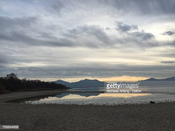 scenic view of calm lake - anfang stock pictures, royalty-free photos & images
