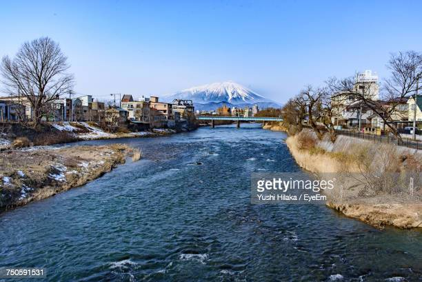 scenic view of calm river against clear blue sky - 盛岡市 ストックフォトと画像