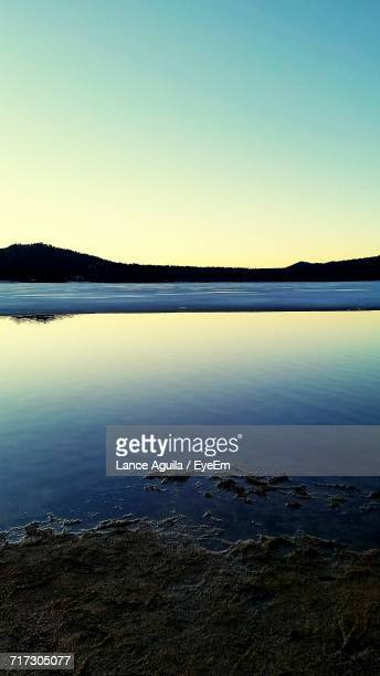 scenic view of calm sea against clear sky - big bear lake stock photos and pictures