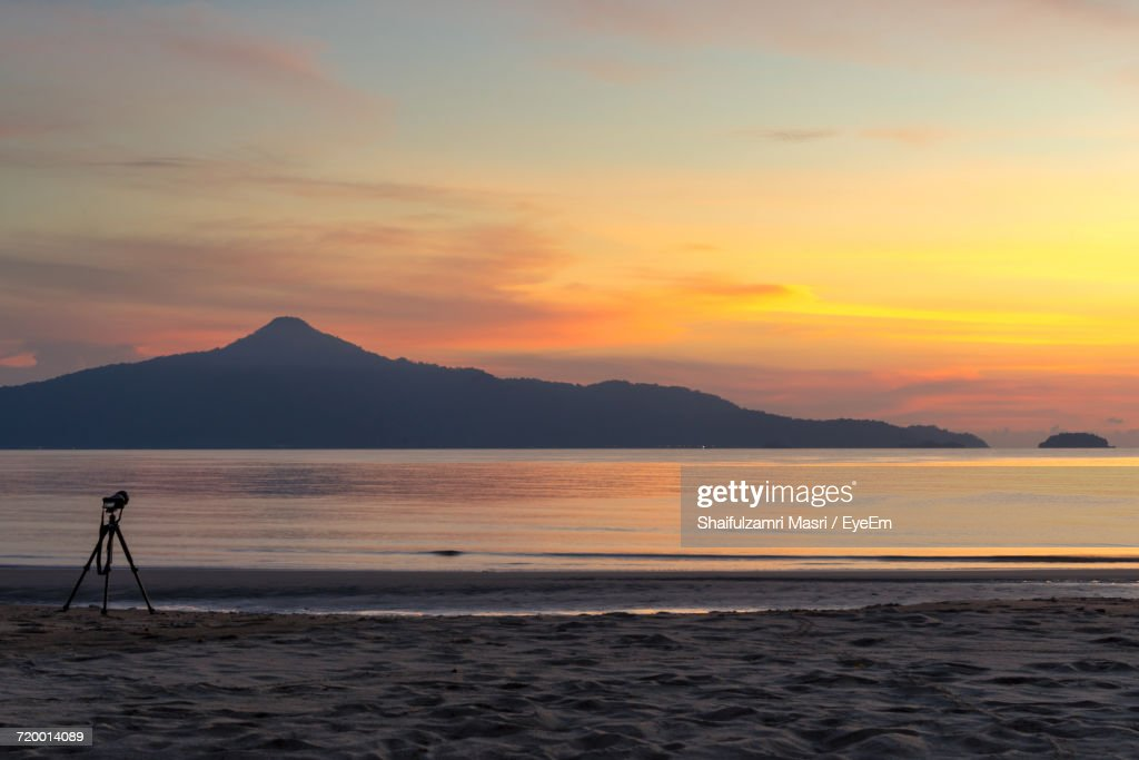 Scenic View Of Calm Sea At Sunset : Stock Photo