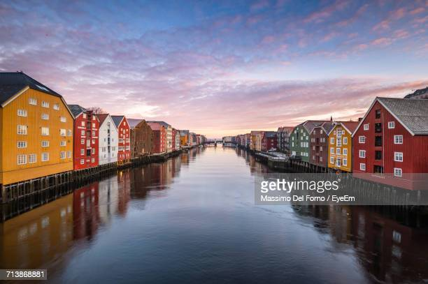 Scenic View Of Canal Against Sky At Sunset