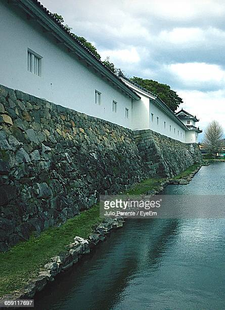 Scenic View Of Canal Along Residential Building