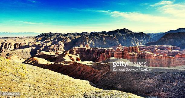 Scenic View Of Canyons Against Sky