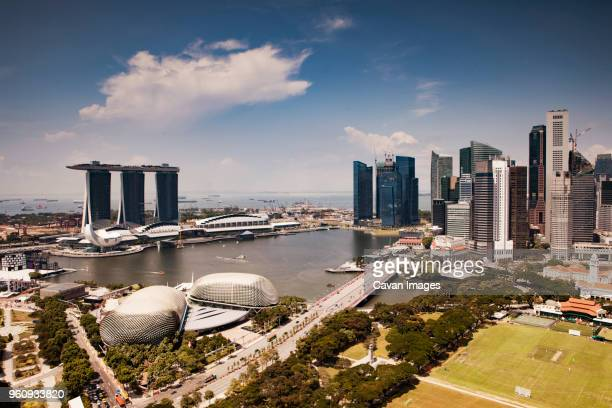 scenic view of capital city and river against sky - marina bay sands stock-fotos und bilder