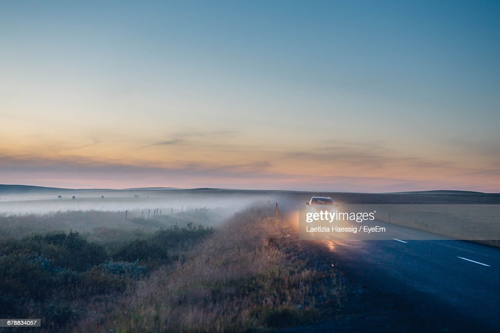 Scenic View Of Car Driving Through Countryside : Stock Photo
