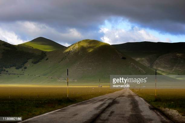 scenic view of castelluccio near monte sibilini national park perugia  umbria italy - umbria stock pictures, royalty-free photos & images
