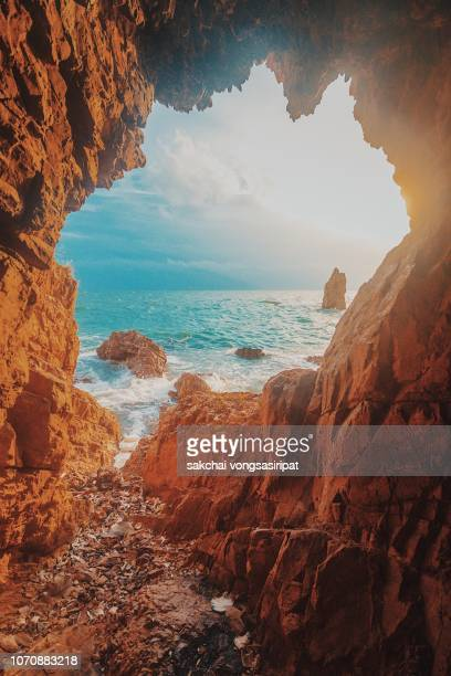 scenic view of cave rock against sky during sunset, thailand - laguna fotografías e imágenes de stock