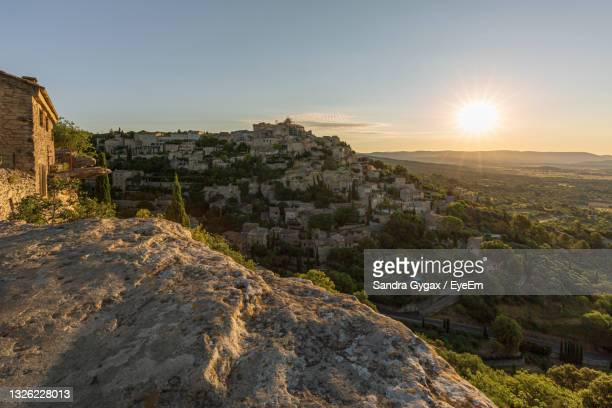 scenic view of cityscape against sky during sunset - sandra gygax stock-fotos und bilder