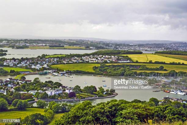 scenic view of cityscape against sky - plymouth stock photos and pictures