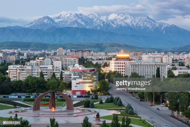 scenic view of cityscape and mountains - kyrgyzstan stock pictures, royalty-free photos & images