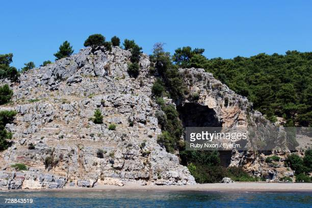 Scenic View Of Cliff Against Clear Blue Sky