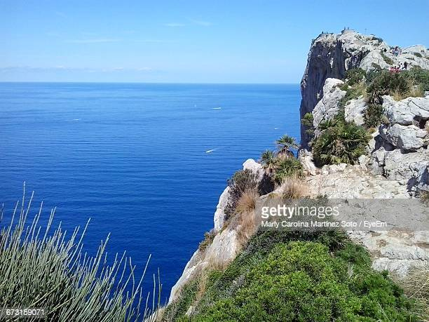 Scenic View Of Cliff And Blue Sea Against Sky