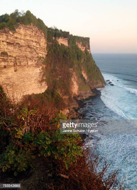 Scenic View Of Cliff By Sea Against Clear Sky