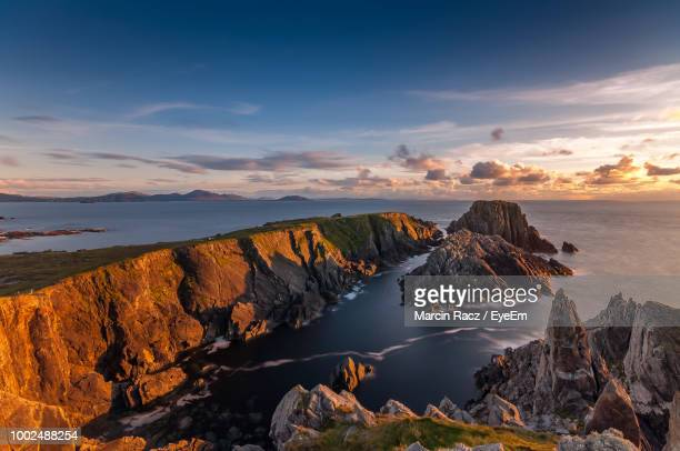scenic view of cliffs and sea against sky during sunset - county donegal stock photos and pictures