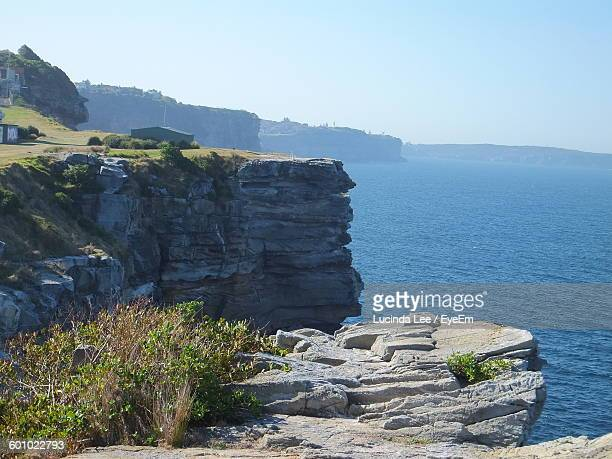 scenic view of cliffs and sea - lucinda lee stock photos and pictures