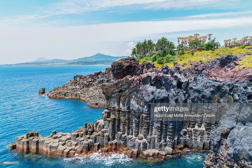 Scenic View Of Cliffs By Sea Against Sky : Stock Photo