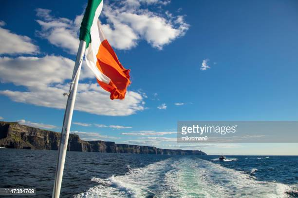 scenic view of cliffs of moher, liscannor, ireland - irish flag stock pictures, royalty-free photos & images