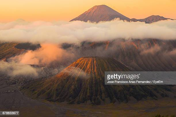 scenic view of clouds over mt bromo during sunset - yogyakarta stock photos and pictures