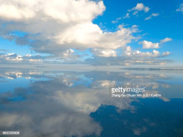 scenic view of clouds over sea - salt flat stock pictures, royalty-free photos & images