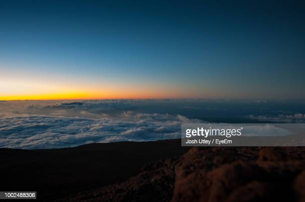 Scenic View Of Cloudscape Against Blue Sky During Sunset