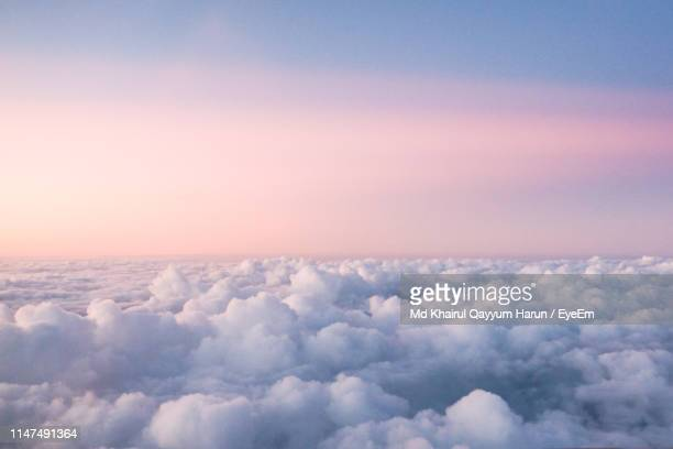 scenic view of cloudscape against sky during sunset - sopra foto e immagini stock