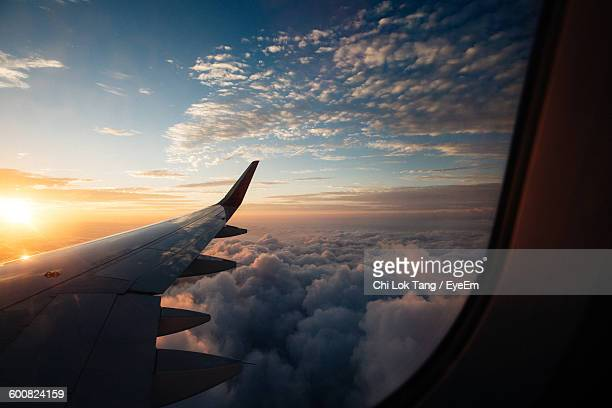 scenic view of cloudscape seen from airplane window - aircraft wing stock pictures, royalty-free photos & images