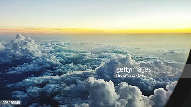 Scenic View Of Cloudy Sky At Sunset Seen Through Airplane Window