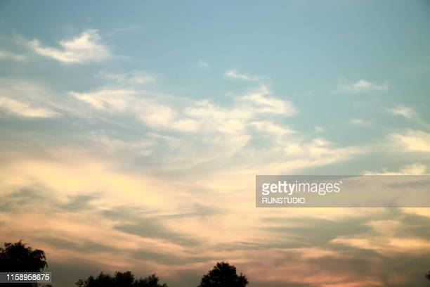 scenic view of cloudy sky during sunset - 夕暮れ ストックフォトと画像
