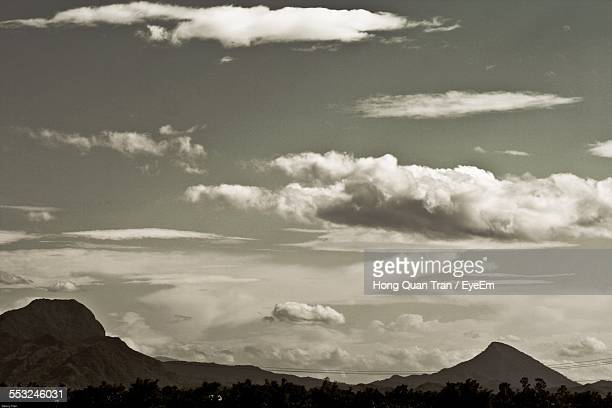 scenic view of cloudy sky over mountains - hong quan stock pictures, royalty-free photos & images